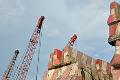 Crane hook and stack of concrete barriers Stock Images
