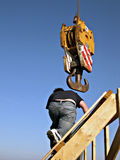 Crane hook and workman Stock Photos