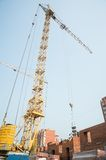 Crane on house construction Royalty Free Stock Photo