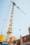 Crane on house construction Royalty Free Stock Photo
