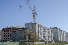 Crane on housing estates Royalty Free Stock Photo