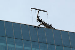 Crane installed on roof of a skyscraper royalty free stock image