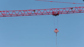Crane jib turns and carriage starts to move stock video