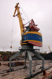 Crane at Kolyma river port Royalty Free Stock Photo
