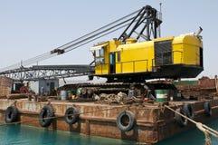 Crane la excavación del puerto imagen de archivo