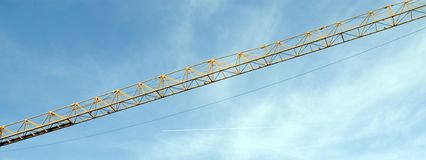 Crane. Latticed boom of a construction crane with hoist rope Royalty Free Stock Photo