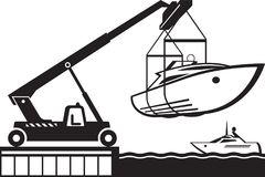 Crane launching yacht in water Royalty Free Stock Image