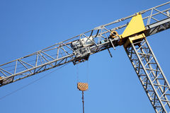 Crane Leaning. Detail on a leaning crane over blue. Danger on overweight concept royalty free stock photos