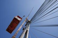 Crane lift on suspended bridge Royalty Free Stock Photo