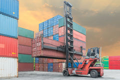 Crane lifter handling container box loading to depot Stock Photography