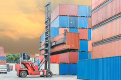 Crane lifter handling container box loading to depot Royalty Free Stock Photo