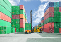 Crane lifter handling container box loading to truck.  royalty free stock photo