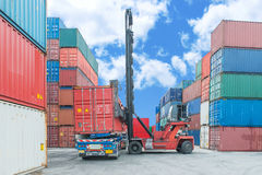 Crane lifter handling container box loading to truck Stock Images
