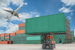 Crane lifter handling container box loading to truck.  stock photos