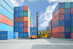 Crane lifter handling container box loading to truck. At dock stock photos