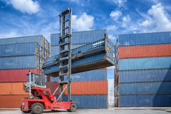 Crane lifter handling container box loading Stock Photo