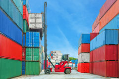 Crane lifter handling container box loading to truck. In import export logustic zone royalty free stock image