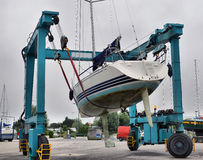 Crane lifting boats Stock Photos