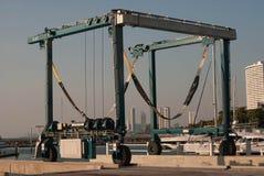 Crane Lifting Boats At Harbor Stock Photos