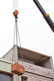 Crane lifting cargo Stock Image