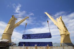 Crane lifting cargo Stock Photography