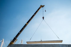 Crane lifting cement block Stock Photography