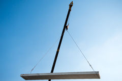 Crane lifting cement block Stock Photos