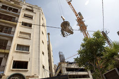 Crane lifting cement, Lebanon Stock Photo