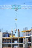 Crane lifting cement mixing container Stock Photography
