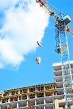 Crane lifting cement mixing container Stock Photos