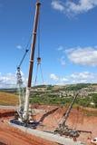 Crane lifting a concrete bridge beam Royalty Free Stock Images