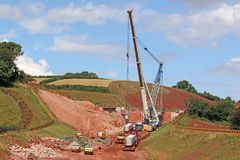 Crane lifting a concrete bridge beam Stock Image