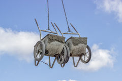 Crane lifting concrete wheelbarrow at constructoin site Stock Images
