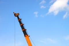 Crane lifting construction materials Royalty Free Stock Photo