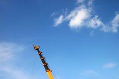 Crane lifting construction materials Royalty Free Stock Photography