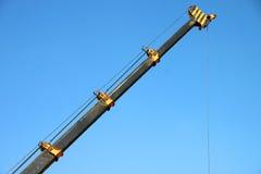 Crane lifting construction materials Royalty Free Stock Images