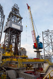Crane lifting equipment. In offshore oil rig stock images