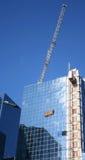 Crane lifting load Stock Photos