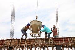 Crane lifting mixed concrete container Stock Photos