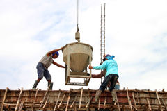 Crane lifting mixed concrete container royalty free stock photography