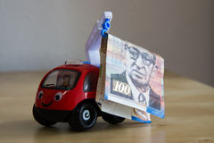 Crane lifting money Royalty Free Stock Photo
