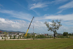 Crane lifting precast concrete wall . Royalty Free Stock Photos