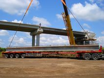 Concrete beam on truck stock photography