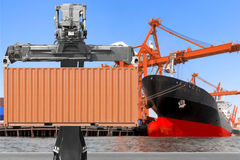Crane lifting up container to commercial delivery cargo containe Royalty Free Stock Photography