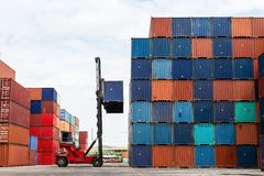 Crane lifting up container Stock Images