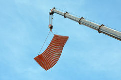 Crane lifts armature on the construction site Royalty Free Stock Photos