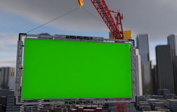 Crane lifts the billboard. city landscape Royalty Free Stock Photography