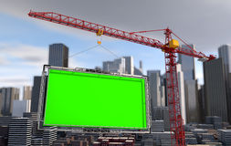 Crane lifts the billboard. city landscape Stock Images