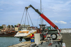 Crane lifts a boat Royalty Free Stock Photography