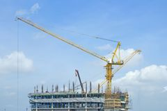 Crane lifts building with construction workers royalty free stock photos